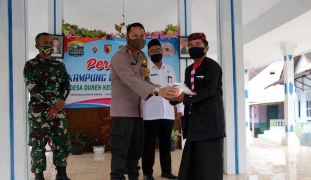 Kapolres Lumajang AKBP Deddy Foury Millewa menghadiri peresmian Kampung Tangguh