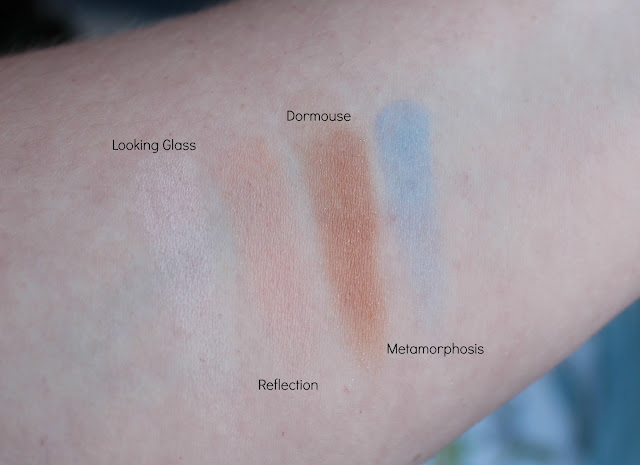 Photo of swatches of The Alice Shades from the Urban Decay Alice Through the Looking Glass Palette