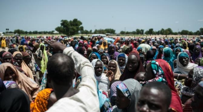 """Boko Haram Islamists have frequently attacked villages, churches and mosques across northeast Nigeria and beyond since 2009. By Stefan Heunis (AFP/File). Abuja (AFP) - Two suspected Boko Haram attacks in northeast Nigeria have left up to 14 people dead and three soldiers wounded, the army and local residents said on Monday.  On Monday afternoon, six people were killed in an ambush of a commercial convoy escorted by the military in the Sanda district of Borno state. """"Suspected elements of the remnants of Boko Haram terrorists who were foraging for food, ambushed troops... escorting commercial vehicles from Damboa to Maiduguri,"""" said army spokesman Sani Usman. """"Unfortunately, five civilians lost their lives at the incident and another died on the way to the hospital,"""" he said. """"Three soldiers also sustained injuries."""" Another attack took place on Sunday when eight people were killed outside a church by suspected Boko Haram gunmen on bicycles shortly after morning service in Kwamjilari village, about 30 kilometres (19 miles) east of the town of Chibok, in Borno state."""