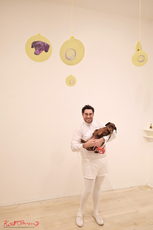 Artist's Portrait, David Capra & Teena the Dachshund at the launch of, EAU DE WET DOGGE at Gallery 9. Photography by Kent Johnson for Street Fashion Sydney.