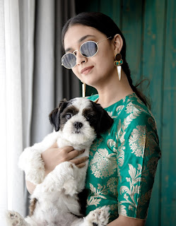 Keerthy Suresh in Green with Cute and Awesome Smile with a Cute Dog 1