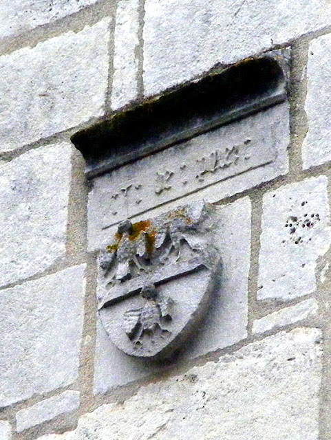 Coat of arms above church door, Concremiers, Indre, France. Photo by Loire Valley Time Travel.