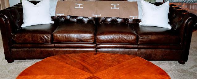 H Blanket on chesterfield sofa, with cream velvet pillows