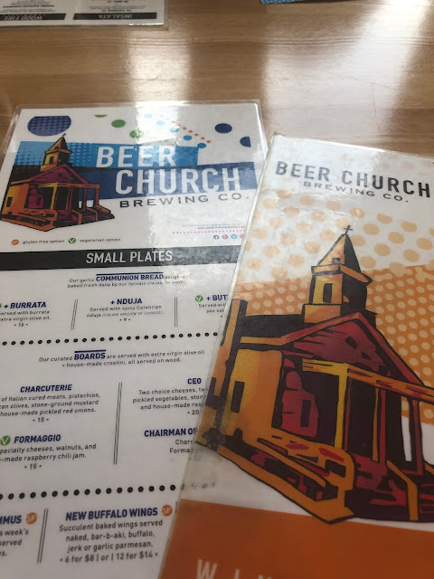 Perusing menus at Beer Church Brewing Co in New Buffalo, Michigan