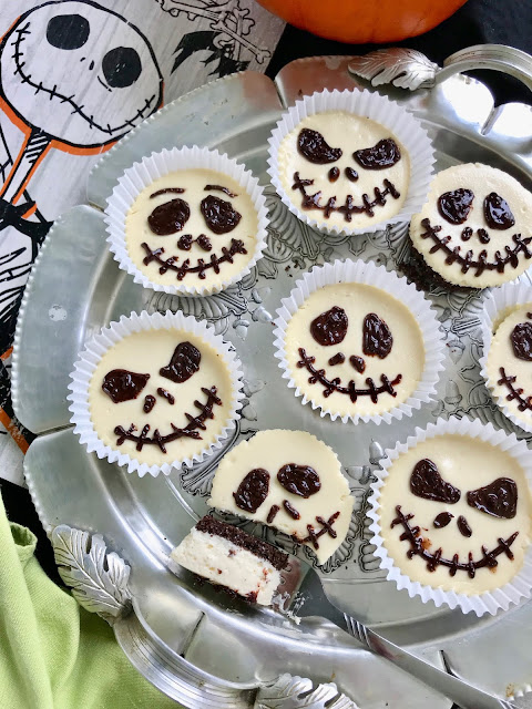 Individual Jack Skellington cheesecakes are not only delicious, but they are also a super fun Halloween dessert or party treat! These creamy little cheesecakes with a chocolate graham cracker crust are sure to please.