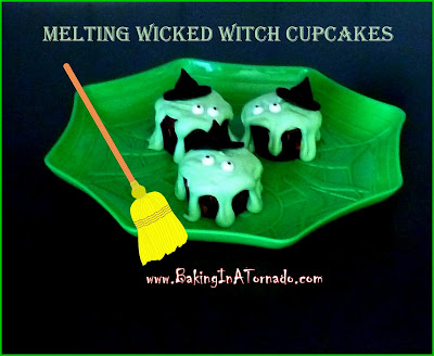Melting Wicked Witches Cupcakes: rich chocolate syrup cupcake with a sweet melting wicked witch frosting. Garnished with candy eyes and an edible witch's hat | Recipe developed by www.BakingInATornado.com | #recipe #Halloween