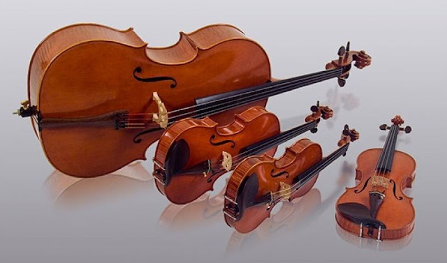 These string instruments are four in number. The instruments include two violins, a viola, and a cello.