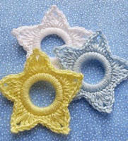 http://www.ravelry.com/patterns/library/star-christmas-ring-ornament?buy=1