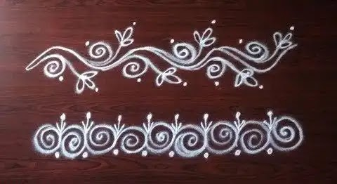 simple white border rangoli made up of chawk