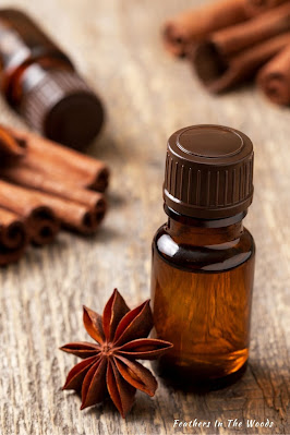 essential oils for stress in small amber glass bottle