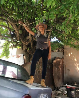 Maya Fahey's mother Victoria Rowell standing on classic car