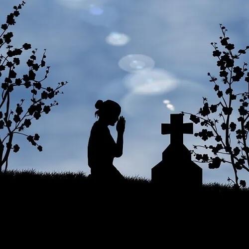 sad alone girl praying