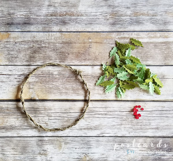 wire wreath form with felt holly leaves and berries