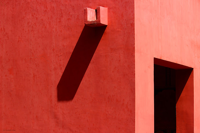 Minimalist Photo of Open Door and Water outlet on a Red wall for SEO
