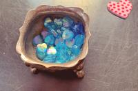blue mini beads in small metal dish