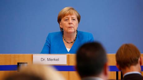 World : Merkel reveals she has no regrets over 2015 migrant influx, claims she would let 1 million into Germany again