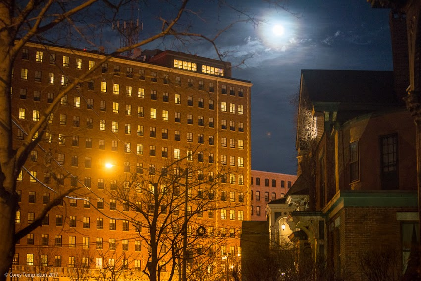 Portland, Maine USA January 2017 photo by Corey Templeton of the full moon over Deering Street and Eastland Westin Hotel Top of the East Lounge.