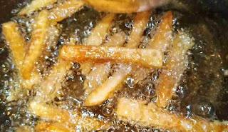 Deep frying potato fingers for honey chilli potato recipe