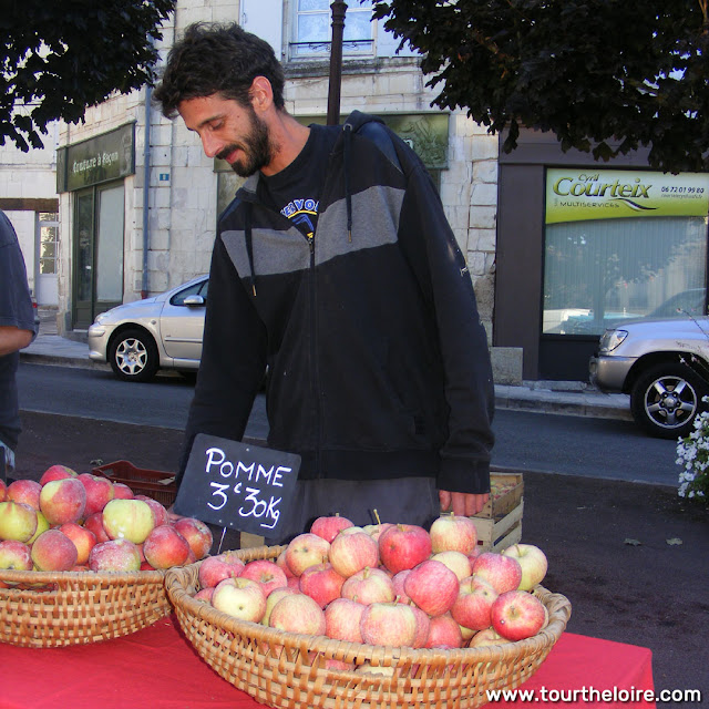 Organic orchardist at a market, Indre et Loire, France. Photo by Loire Valley Time Travel.