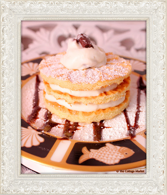 This pizzelle stack served with layers of canoli cream and chocolate syrup is delicious.
