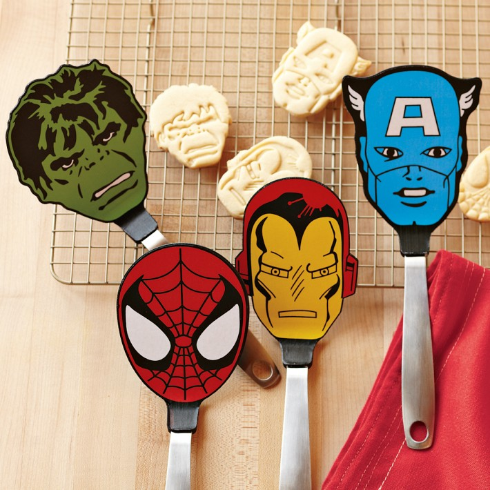 Hulk, Spider-Man, Iron Man, and Captain America's heads at the end of spatulas, with cookie sheet