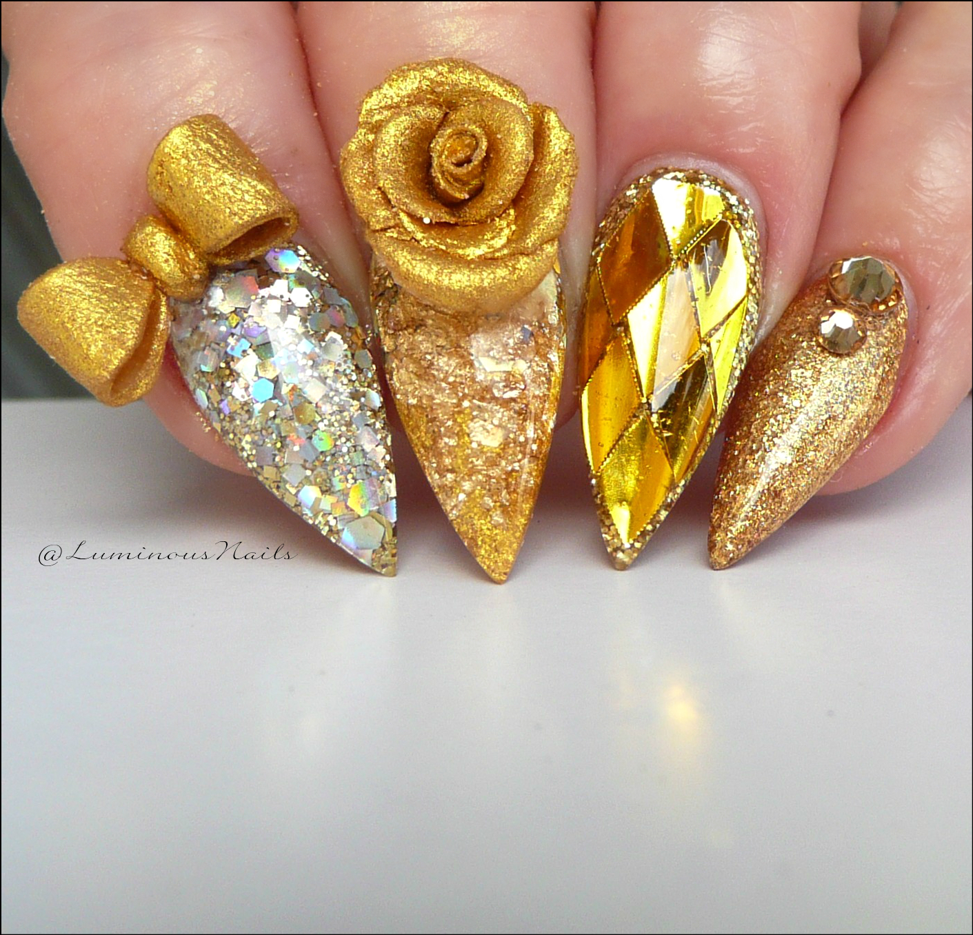 Liquid Gold Acrylic Nails With Bow Metallic Feature