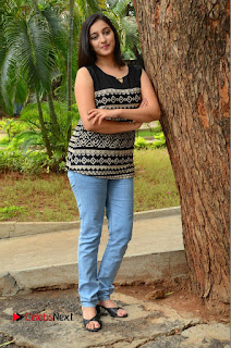 Actress Mouryani Pictures in Denim Jeans at Ardhanari Movie Success Meet  0202.JPG