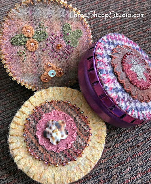Small Stitching Treasures - Candy Tins covered with wool, embroidery, buttons and beads by Rose Clay at ThreeSheepStudio.com