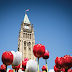 "Two ways to say ""Happy Birthday Canada"" in red and white with 150th Celebration Gardens"