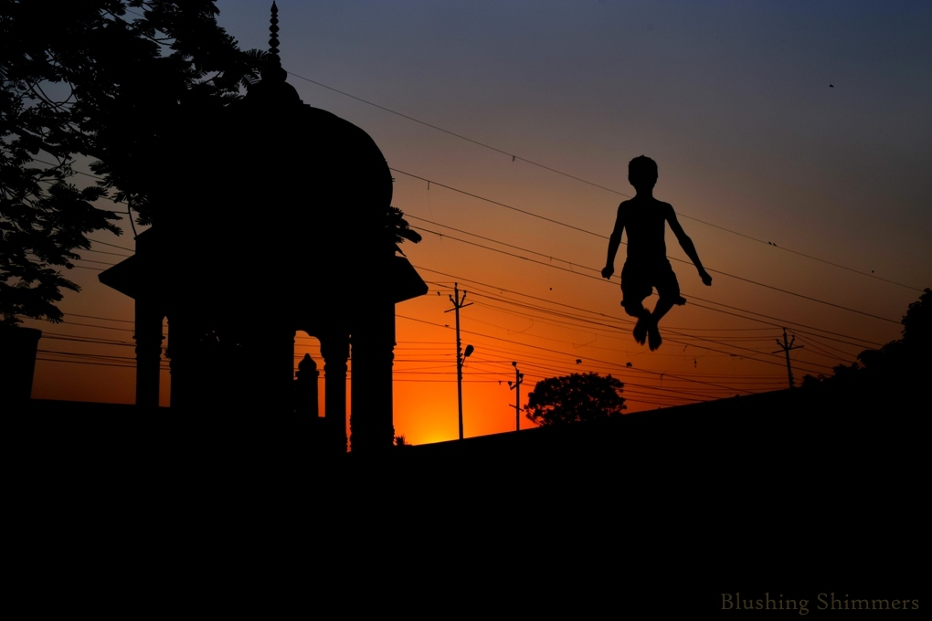 child jumping silhouette