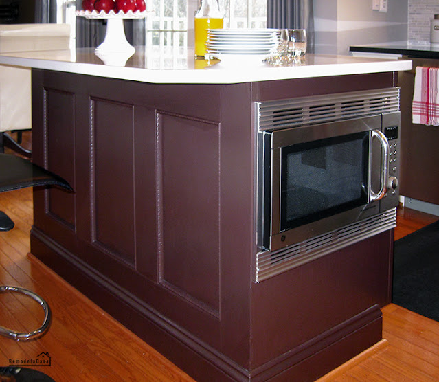 How to install a microwave inside a kitchen island adding metal trim around it and installing a shelf on the other side.