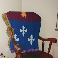 Acadian Flag Throw over a rocking chair