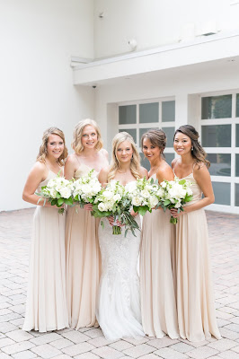beige bridesmaids dresses with white bouquets