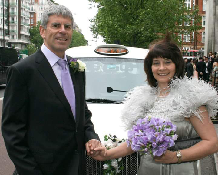 London wedding at Marylebone register office with white London cab as transport