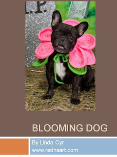 http://www.redheart.com/free-patterns/blooming-dog