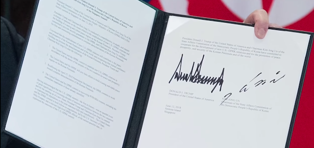 President Donald Trump Kim Jong Un United States America North Korea summit signatures paper