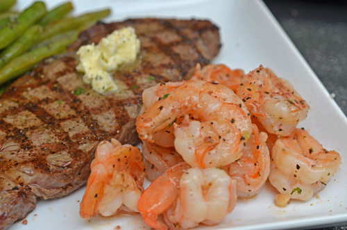 Prime Certified Angus Beef Brand NY Strip Steak from Food City with buttery shrimp.