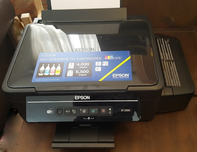 Epson Eco Tank Printer on desktop showing control panel and paper feed