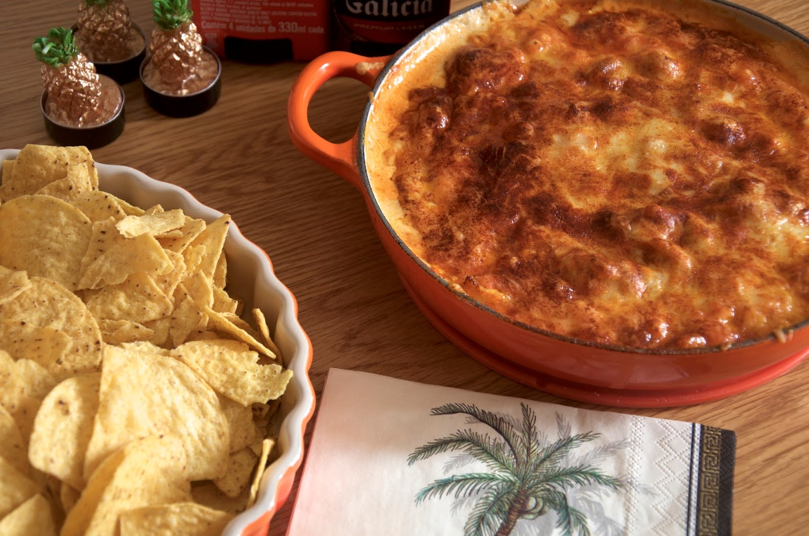 cheesy buffalo chicken dip with tortilla chips and palm tree napkin