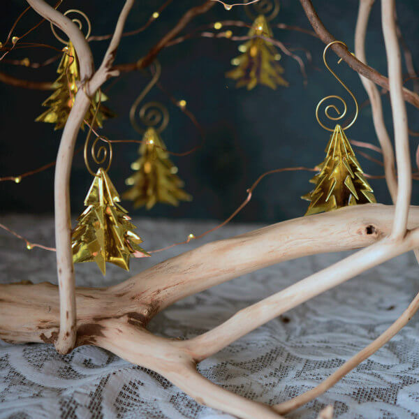golden metallic paper origami tree ornaments on branches with S scroll hangers