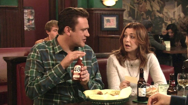 Marshall, holding a bottle of ketchup labeled 48, speaking with Lily