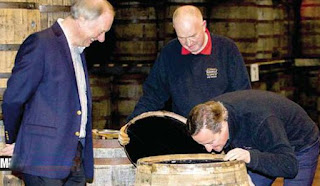 David Cameron Smells A Whiskey Barrel
