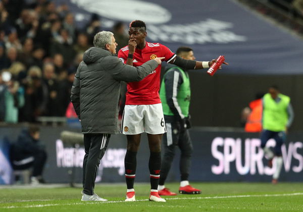 Paul Pogba of Manchester United speaks to Jose Mourinho, Manager of Manchester United during the Premier League match between Tottenham Hotspur and Manchester United at Wembley Stadium on January 31, 2018 in London, England