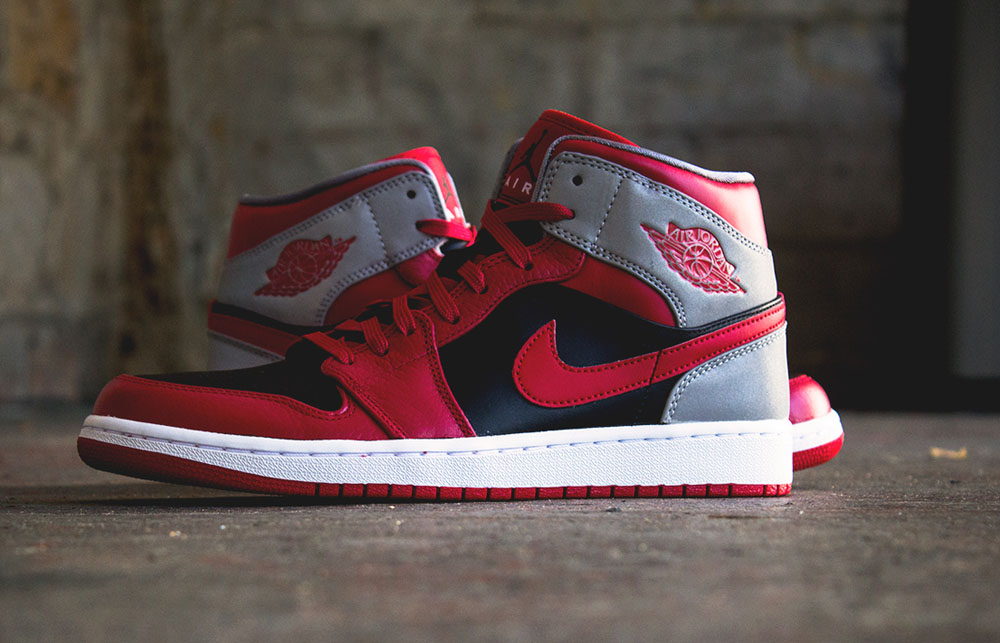 This new look Air Jordan 1 Retro keeps things classic with their iconic  color scheme and AJ V-inspired 3M reflective detailing. Fire Red and black  sparks a ... bc35ce4d4e34