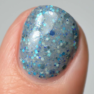grey nail polish with glitter close up swatch