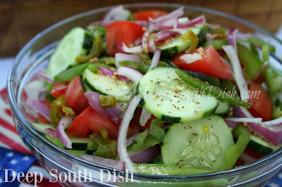 One of my favorite southern salads for the summer, this spicy, sweet and sour Fire and Ice salad, gets it's name from the contrast between the red onion, green bell pepper, horseradish and jalapenos, and the cool crunchy cucumber and sweet tomatoes.