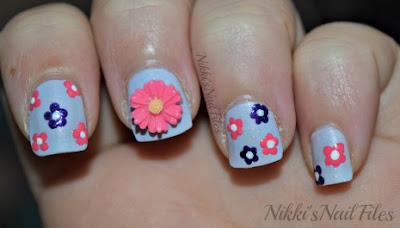 purple manicure with flowers