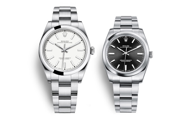 Rolex - Oyster Perpetual 39 White Dial Ref. 114300 and Oyster Perpetual 34 Black Dial Ref. 114200