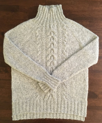Cabled raglan pullover with mock neck knitted with DROPS Air Pearl Grey