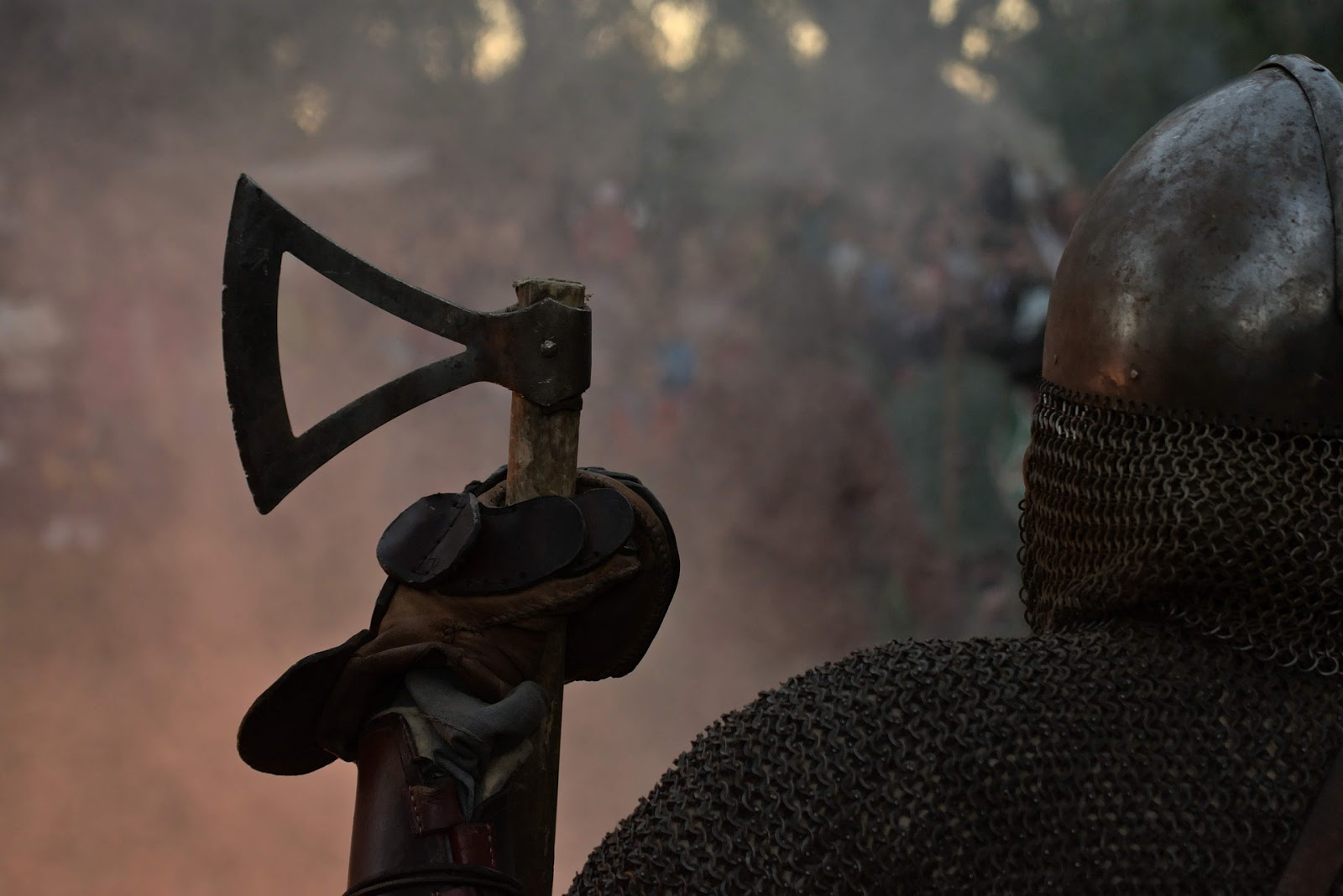 a viking soldier faces away from the camera and holding a battle ax to illustrate a blog post about the movie the 13th warrior